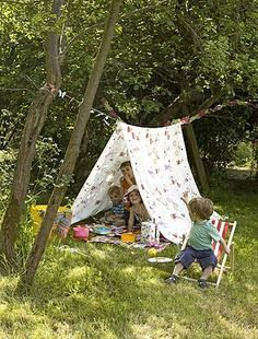 String a rope in your backyard... let the kids bring out a bedsheet & drape it over... weigh it down on the edges. Sprawl out a blanket... let them have their very own picnic & day play camp out!
