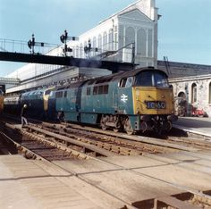 Western Class 52 D1017 Western Warrior and Warship Class 42 D812 The Royal Naval Reserve 1859–1959 at Exeter St Davids on 22-05-70