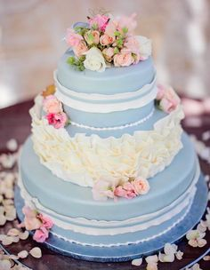 If you're opting for a more romantic and feminine theme, don't think you have to commit to pink. This ruffled and rose-adorned blue cake is sweet as sugar! | Something Blue Wedding Cakes for a Fresh Take on a Classic Tradition