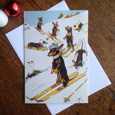 I dont just do cats!!! This Christmas card shows a humorous illustration of a skiing dachshund who has lost his sticks and is looking slightly worried! The background shows other dachshunds, all skiing with various degrees of success. The image has been lovingly restored from an original Victorian Christmas card and has been printed on chlorine-free environmentally friendly cardstock. It measures 115mm x 165mm and is portrait in configuration. Inside, it simply says Seasons Greetings. The…