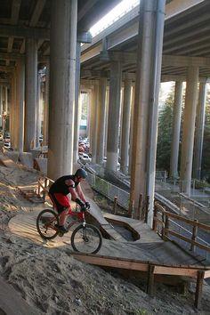 mountain bike park under and interstate...genius!