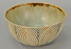 Axel Johannes Salto (1889-1961) Royal Copenhagen bowl, stoneware with bluish red sung glaze and fluted style decoration, circa 1940, marked 20720 Denmark Salto.  ht. 2 1/2 in.; dia. 4 1/2 in.  Estimate: $600 - $800
