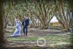Bride and groom walk in the park. Wellington weddings by PaulMichaels photography http://www.paulmichaels.co.nz/bede-dawn-wedding/