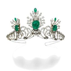 EMERALD AND DIAMOND TIARA The tiara designed as a series of graduated scrolls highlighted with three sprays each set with cabochon emerald drops, set with rose, French-, single- and circular-cut diamonds, inner circumference approximately 325mm, each jewel detachable, can be worn as a pair of earrings and a brooch, maker's marks, earrings with clip fittings.