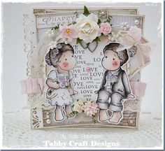 Uses 3 stamps from Magnolia stamps.  Sitting Wedding Edwin, Sitting Wedding Tilda, and love heart