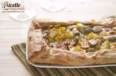 Una torta salata gustosa e nutriente, con i carciofi, le patate e il formaggio Asiago. Si può gustare calda ma anche fredda, magari durante un pic nic prim