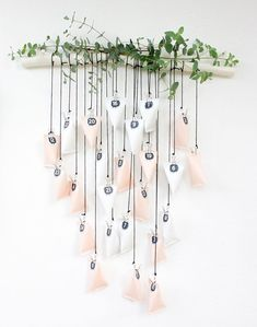 Homemade Advent Calendars For Kids. Hanging advent calendar in white and blush hung from branch. Homemade Advent Calendars, Diy Advent Calendar, Countdown Calendar, Calendar Ideas, All Things Christmas, Christmas Holidays, Christmas Crafts, Christmas Decorations, Xmas