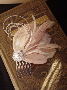 Wedding Fascinator, Bridal Head Piece, Feather Fascinator, Nude and Pink Champagne Feather Hair Clip - FAWN- Made to order. $52.00, via Etsy.