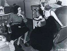 Gloria Swanson visits Carole Lombard on the set of Fools for Scandal, 1938, directed by Mervyn LeRoy.