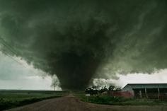 Eight tornadoes were intercepted between Hartington, Coleridge and Laurel, Nebraska on June 17th, 2014. (two seen here) To license tornado video contact hank...