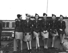 Eight female war correspondents who covered the U.S. Army in the European Theater during World War II appear together in this1943 photograph.  (U.S. Army Center of Military History)