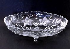 Floral Bowl Large Depression Crystal Glass Flower Cuttings    Looking for a large center piece bowl for the dining table?  This is it!  Nice large vintage oval shaped bowl that will look great on a dining table with or without decorative items in it.     This Depression Glass treasure was made from a heavy lead glass figured blank and decorated with cuttings of flowers.     The beautiful crystal quality of the glass, it's large oval size, and it's four feet make this treasure will you will…