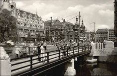 1959. View on the Leidseplein in Amsterdam. In the foreground the Leidsebrug. On…