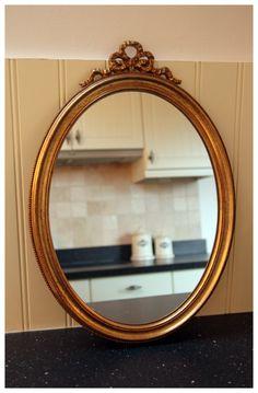 Brocante ovale spiegel met strik