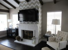 Love the chevron fireplace wall.