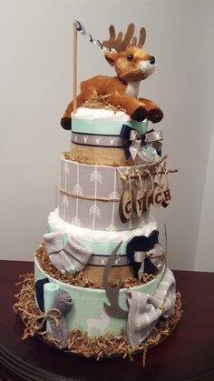Woodland Deer diaper cake. Baby shower centerpiece gift. Over 75 diapers included! Check out my Facebook page Simply Showers for more pics and orders. Thank you! Kim