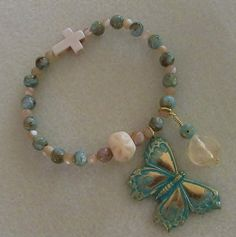 Shell Beads and Mother of Pearl Charm Bracelet by VintageMirageJewelry on Etsy
