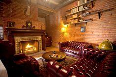 Carondelet House Gallery-hells yea!! Globe, fireplace, animal head check!