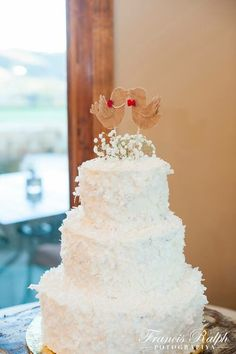 Joanna & Mark's cake - vanilla bean cake filled with fresh strawberries & vanilla buttercream, topped with large flake coconut.