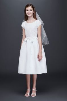 This classic lace and satin communion dress is finished with a small keyhole opening in the back.  By US Angels  Polyester  Back zipper; fully lined  Dry clean  Imported