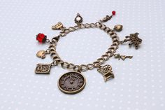 Once Upon A Time charm bracelet - Fairytale charm bracelet by otterlydesign, $35.49    Strike a deal with Rumpelstiltskin, go out in the woods with Red, have look in Henry's book or a chat with the Blue Fairy - all in a day's work in Storybrooke now that the magic is back!    Whether you love the inhabitants of Storybrooke or just fairy tales in general, this sweet little charm bracelet is for you!