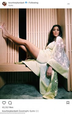 'Goodnight Kyoto!' Kourtney Kardashian shows off her legs as she reclines in a chemise and kimono