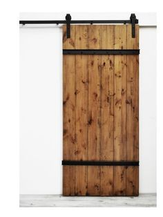 The Drawbridge Barn Door features sturdy wood planks lightly distressed and bolted together with metal plating. This sliding door style is well suited for rustic spaces, but also fits in modern applic
