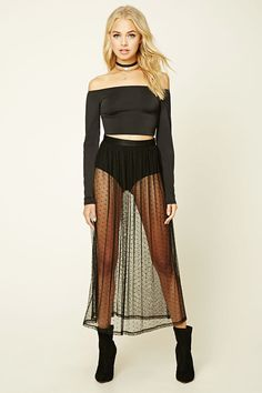A sheer maxi skirt featuring a polka-dot mesh fabric, pleated design, and a concealed back zipper. Slip not included.