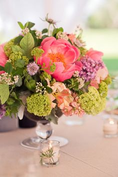 Beautiful and bright centerpiece: http://www.stylemepretty.com/michigan-weddings/2014/09/16/michigan-farm-wedding-full-of-rustic-elegance/ | Photography: Chelsea Brown - http://www.chelseabrownphotography.com/