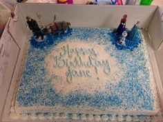 Easy Frozen Birthday Cake... white sheetcake from costco with wilton blue sugar sprinkles and sugar gems with disney store figurines