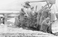 Korean War: Men of the US Army14th Combat Engineer Battalion return fire at the communist forces across a river.