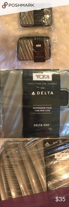 Delta Tumi Travel Bags Lot of 2, brand new in the plastic Tumi bags.   Delta's TUMI hard-case amenity is based off of the company's 19 Degree collection allows customers to monogram a patch on the front of the case.  Kits includes: facial tissues, toothbrush, eye shade, hand cleanser, polyester socks, twist pen,  ear plugs in poly bag, rubber band and card, Kiel's lip balm, Kiel's hand and body lotion  Brand new, still in bag. Received from flying buisness class on Delta. Thanks for lolkkngN…