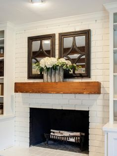 Simple white brick and wood mantel.As seen on HGTV's Fixer Upper Brick Fireplace Makeover, White Fireplace, Cozy Fireplace, Fireplace Remodel, Living Room With Fireplace, Fireplace Design, Fireplace Mantels, My Living Room, Living Room Decor