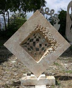 Travertine stone #sculpture by #sculptor Andrej Mitevski titled: 'The fabric of space'. #AndrejMitevski