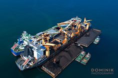 Aerial photograph of Coal transshipment in Kalimantan Indonesia   Photography and video for the maritime & mining industry in Kalimantan Indonesia  #mining #kalimantan #shipping #indonesia #boat #ship #transport