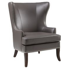 The classic wingback silhouette gets a contemporary twist with this eye-catching accent chair, showcasing nailhead trim and espresso-hued legs.