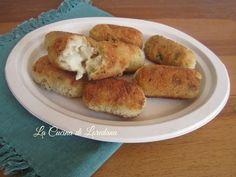 Le Crocchette di Riso e Zucchine con un cuore di mozzarella filante vi…