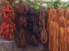 Sausages hanging in the Mercado do Bolhão. Image by Kerry Christiani / Lonely Planet