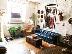 Bohemian living room of Leah Hoffman / love the record player and trunk coffee table #homedecor