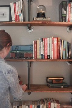 Use Ell and Tee brackets for your black iron pipe rustic industrial whatever bookcases and shelves; it'll allow you to have every other shelf completely free of supports.