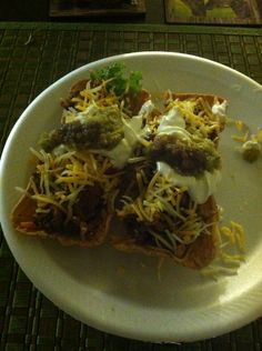 Flat tacos with my moms special/homemade sauce on top
