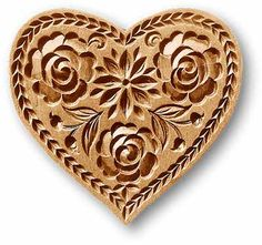 Heart shaped springerle cookie mold - so pretty! Someday I'll treat myself to one!