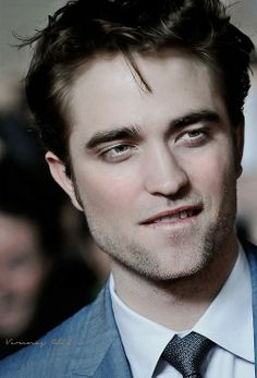 Robert Pattinson:is this the face of a man thinking clean thoughts?No,I didn't think so.   :-)