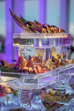 A seafood bar of oysters, stone crab legs and lobsters is chilled by ice sculptures.