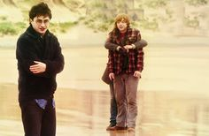 """Super random behind the scenes photo of Deathly Hallows....Emma is hugging Rupert, and he's like aaah she's touching me."""