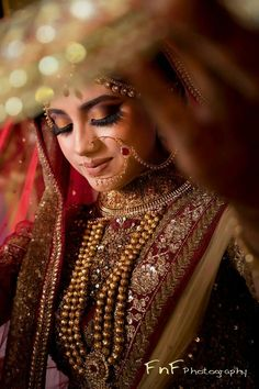 Beautiful bridal shot | Bridal photo shoot inspiration | Must have photos of Indian bride | Bridal portrait | Bride in ghoonghat | Traditional wedding jewellery | Photo Credits: FnF Photography | Every Indian bride's Fav. Wedding E-magazine to read. Here for any marriage advice you need | www.wittyvows.com shares things no one tells brides, covers real weddings, ideas, inspirations, design trends and the right vendors, candid photographers etc.