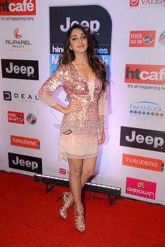 Kiara Advani at HT Most Stylish Awards red carpet The Machine actress looked pretty in a shimmering sequin Halston dress, paired with Roberto Cavalli sandals.