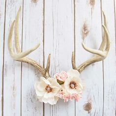 Magnolia - Decorative Floral Deer Antlers by @buffalodaisies This pretty piece was hand made by shop owner Sadie Porter. Buffalo Daisies is all about repurposing and reusing vintage and found objects. From jewelry to decor and art, even my market booth is all made from repurposed items!