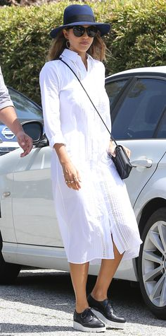 Jessica Alba in a crisp white shirtdress, wide-brim hate, and two-tone brogues.