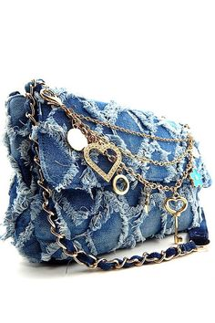 Frayed chevron-shaped detailing and a distressed denim finish add vintage glamour to a compact shoulder bag complete with removable chain decoration for a signature touch. DETAILS - Size: 11L x 3W x 8